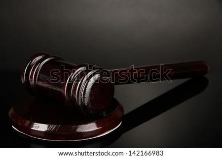 Wooden gavel on grey background - stock photo