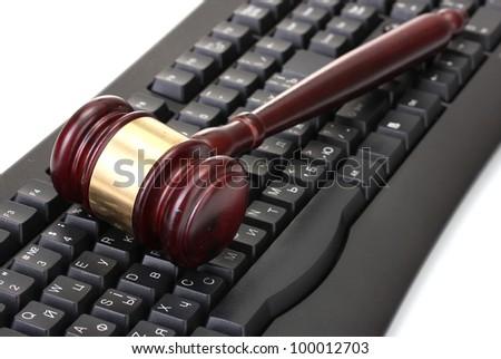 wooden gavel on keyboard isolated on white - stock photo