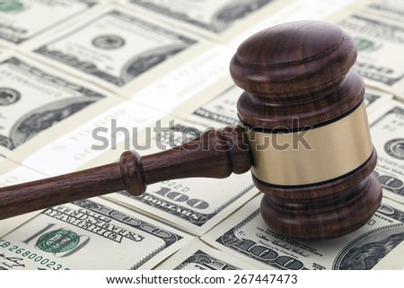 Wooden gavel on one hundred dollar bills - stock photo