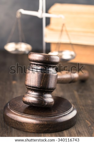 Wooden gavel on table vertical - stock photo