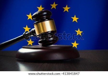 Wooden gavel with European Union flag in background. Justice and law symbol - stock photo