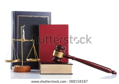 Wooden gavel with justice scales and books, isolated on white - stock photo