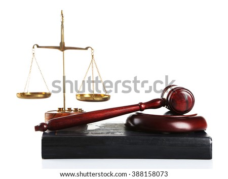 Wooden gavel with justice scales and old book, isolated on white - stock photo