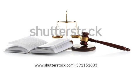 Wooden gavel with justice scales and open book, isolated on white - stock photo