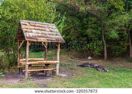 Wooden gazebo in park, early fall, Lviv Ukraine - stock photo