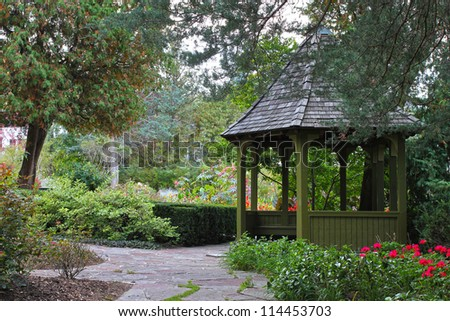 Wooden gazebo surrounded by colorful fall foliage in Toronto park, Ontario, Canada - stock photo