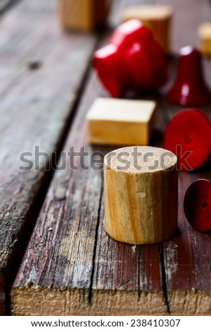 wooden geometric cubes over rustic wooden texture, selective focus - stock photo
