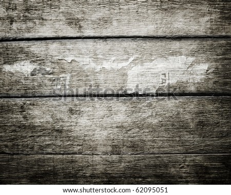 Wooden grunge background with pieces of newspapers - stock photo