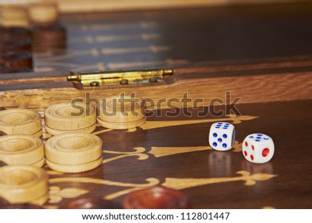 Wooden handmade backgammon board  and two dices - stock photo