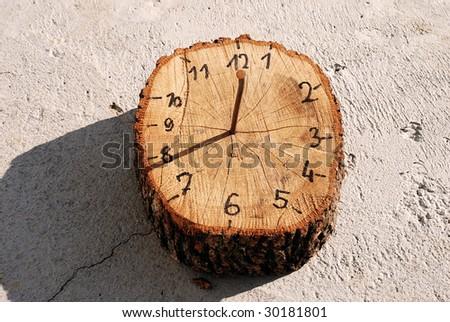 wooden handmade sun-dial clock 8 o'clock outdoor - stock photo