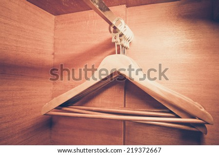 Wooden hangers in the wardrobe, vintage style - stock photo