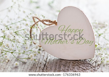 wooden heart shape with text and white flowers for mothers day  - stock photo