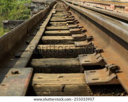 WOODEN HISTORIC RAILWAY TRACK IN KANCHANABURI THAILAND - stock photo