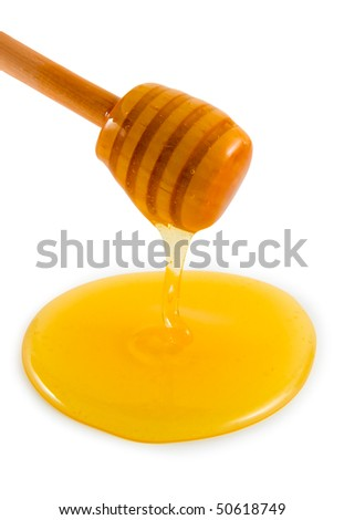 Wooden honey lifter on a white background. - stock photo