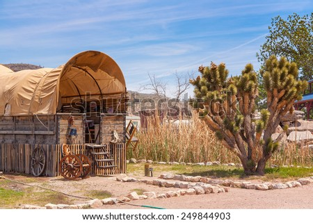 wooden horse barn with blue sky on American ranch. Nevada. USA - stock photo