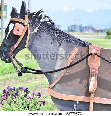 Wooden horse in the farm - stock photo