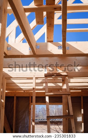 wooden house construction in progress - stock photo