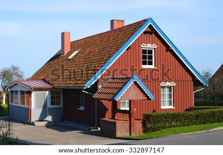 Wooden house in the countryside. Northern Europe - stock photo
