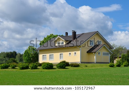 Wooden house in the countryside. Sunny summer day - stock photo