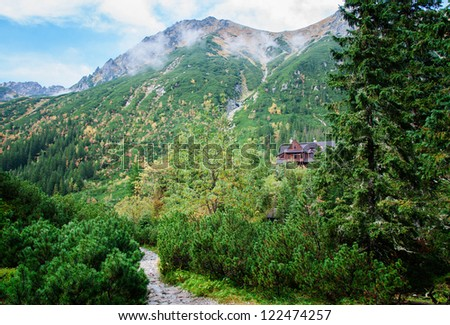 wooden house in the mountains - stock photo