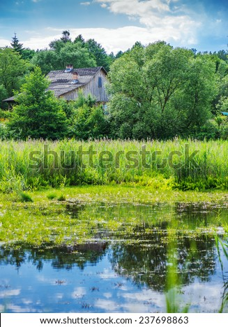 Wooden house near river in Central Russian Upland. - stock photo