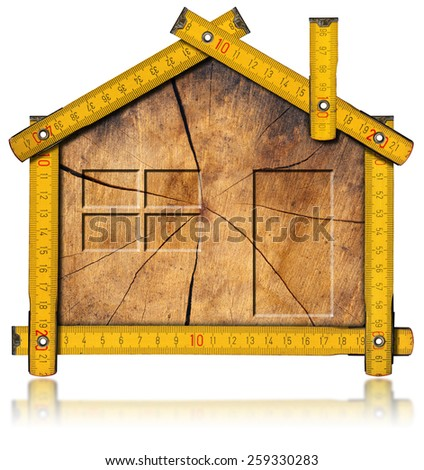 Wooden House Project Concept. Wooden house project concept. Wooden meter ruler in the shape of house with section of tree trunk inside. Isolated on white background  - stock photo