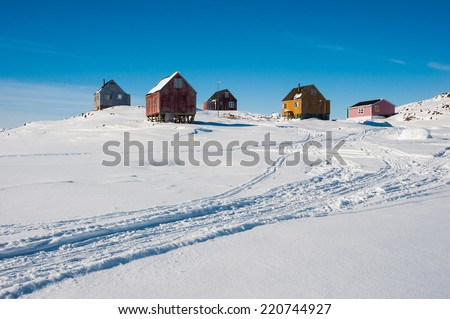 Wooden houses in Kulusuk, small town in East Greenland - stock photo