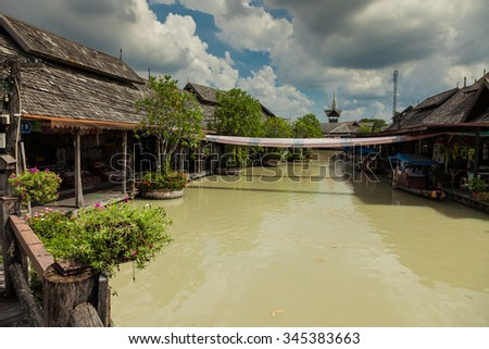 Wooden houses on a canal after a downpour / rain with a dramatic sky. - stock photo