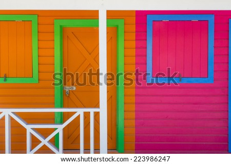 Wooden houses painted in Caribbean colors  - stock photo