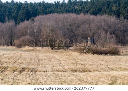 Wooden Hunters High Seat hunting tower in rural Landscape, Czech Republic Scenery  - stock photo