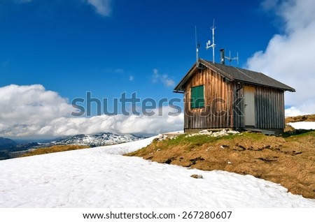 Wooden hut in mountains. Small cabin with antennas on the roof, situated on the Loser Peak in Totes Gebirge, group of mountains in Austrian Alps. - stock photo