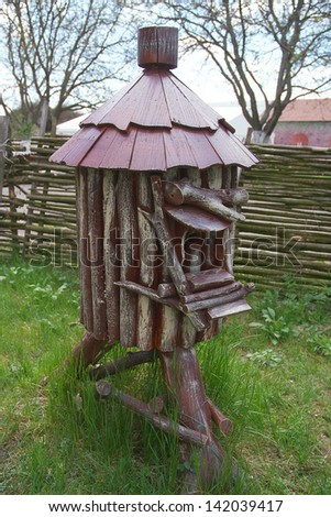 wooden hut on a wooden stump - stock photo