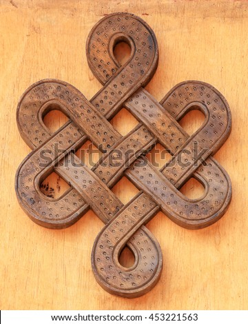 Wooden infinity knot.  - stock photo