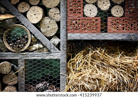 Wooden insect hotel decorative bug house, ladybird and bee home for butterfly hibernation and ecological gardening. Protection for insects concept. - stock photo