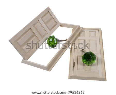 Wooden interior doors with five panels and green crystal doorknobs - path included - stock photo