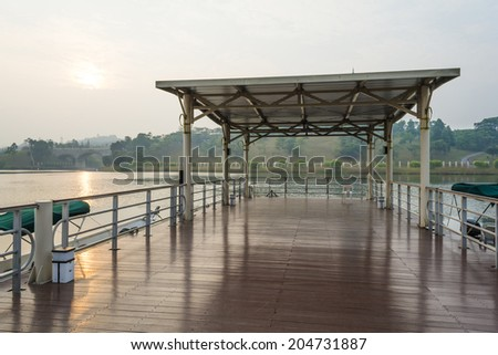 Wooden jetty in morning mist - stock photo