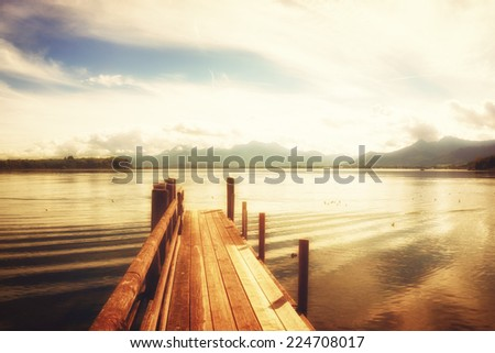 wooden jetty  lake chiemsee, bavaria, germany, europe - stock photo