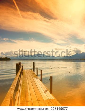 wooden jetty, lake chiemsee, bavaria, germany, europe - stock photo