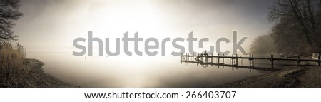 wooden jetty on lake simssee panorama format - stock photo