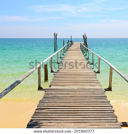 Wooden jetty on tropical beach, Samed island in Rayong province, East of Thailand.  - stock photo