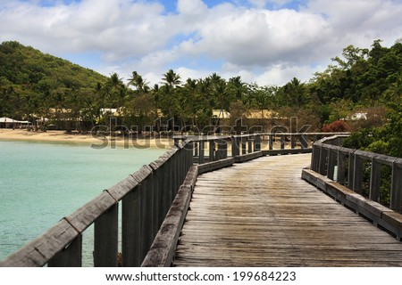 Wooden Jetty which goes to Long Island  - stock photo