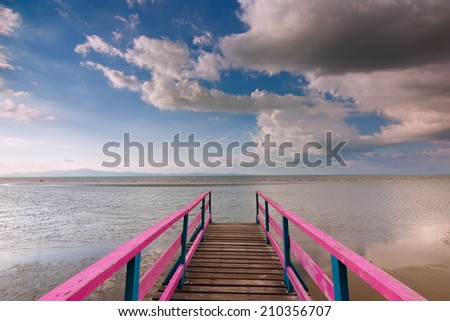 Wooden jetty with blue sky at Sabah, East Malaysia, Borneo - stock photo