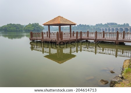 Wooden jetty with morning mist - stock photo