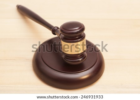 Wooden Judge Gavel And Soundboard On Wooden Table - stock photo