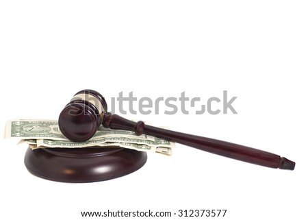 Wooden judge gavel on One dollar banknotes isolated - stock photo