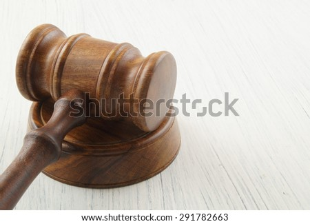 Wooden judge gavel on white table with space for text - stock photo