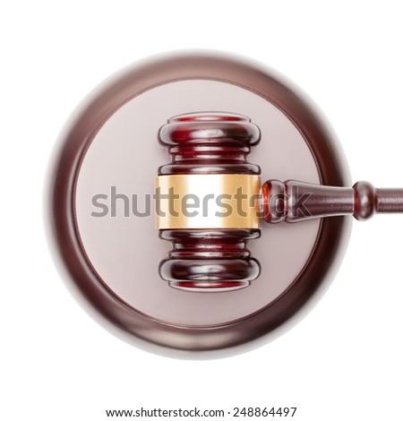 Wooden judge gavel over sound box - studio shot - stock photo