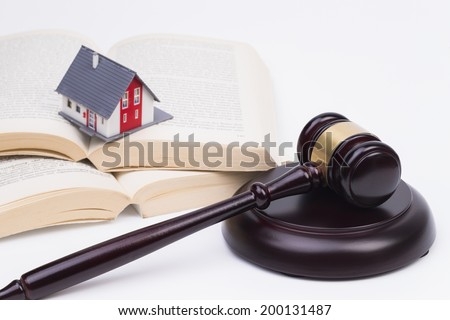 Wooden judge gavel with house isolated on white background  - stock photo