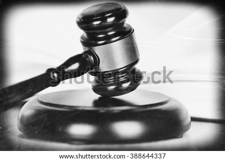 Wooden judges gavel on able, close up. Retro stylization - stock photo