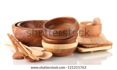 Wooden kitchen utensils isolated on white - stock photo